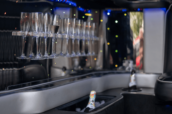 party bus hire gold coast interior photo of champagne glasses